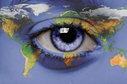 Close up of eye with face painted as the world